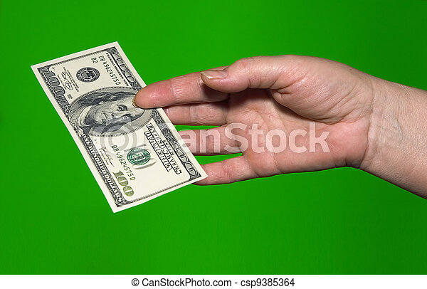fixed asset for the 100 dollars in hand of women on green background - csp9385364