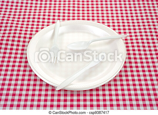 Plastic silverware on plate - csp9387417