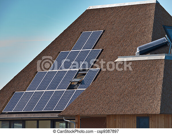 Solar panels on a thatched roof - csp9387897