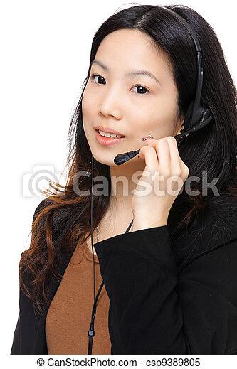 asian woman wearing headset - csp9389805