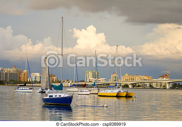 Boats in Harbor Under Cloudy Skies - csp9389919