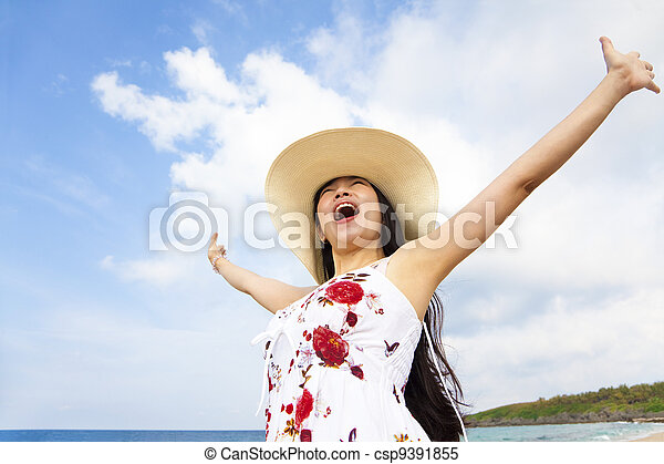 happy young woman raised hands on the beach - csp9391855