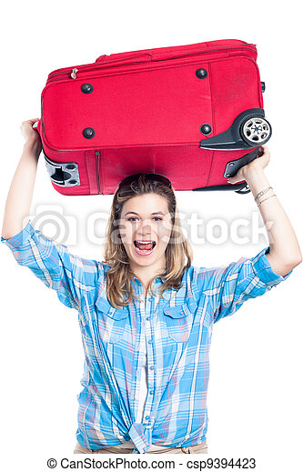 Happy traveller woman with luggage - csp9394423