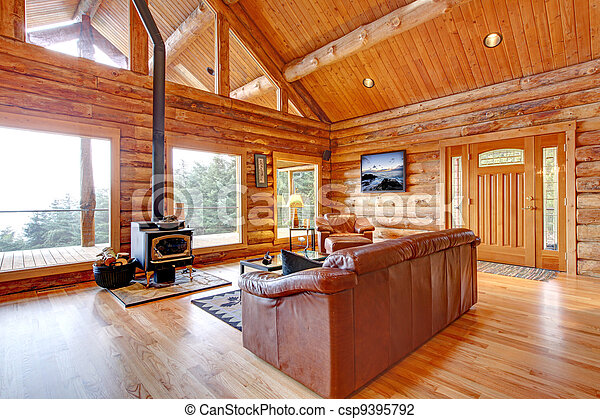 Luxury log cabin living room with leather sofa. - csp9395792