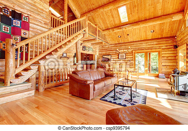 Luxury log cabin living room with leather sofa. - csp9395794