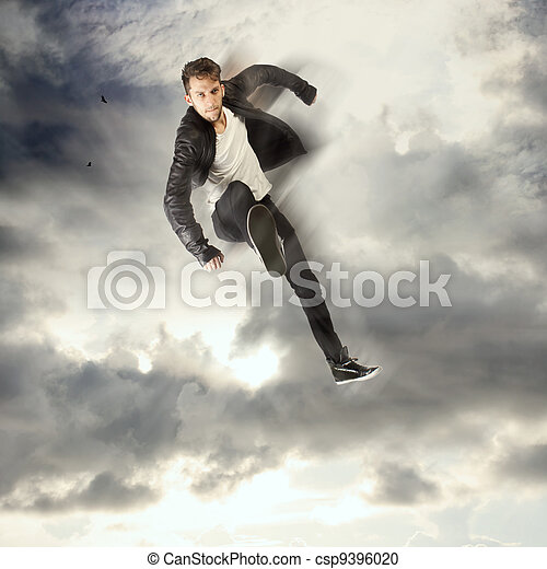 Cool young man jumping and kicking - csp9396020