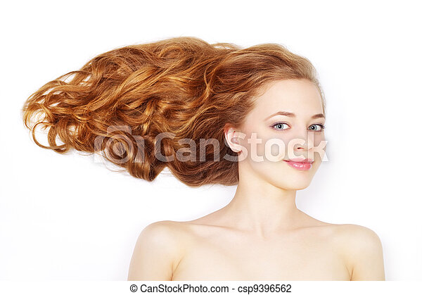 Beautiful girl with long wavy hair on light background - csp9396562
