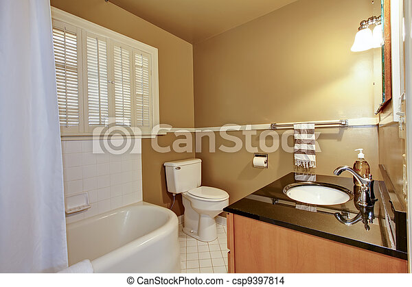 Old brown bathroom with white tub. - csp9397814