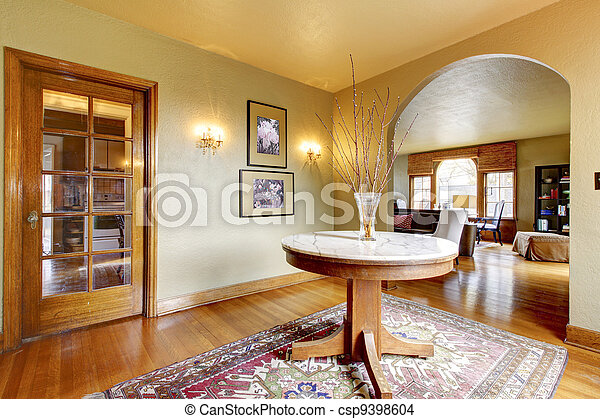 Photo de entr e luxe int rieur maison table rond for Entree de maison interieur