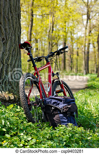 Bike and Backpack against the background of nature in spring - csp9403281