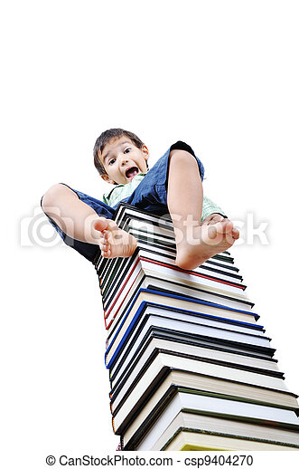 Cute little boy sitting on heap of textbooks - csp9404270