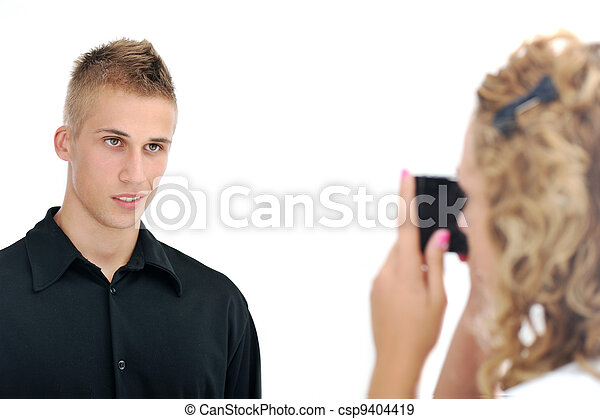 Girlfriend taking picture of her  boyfriend - csp9404419