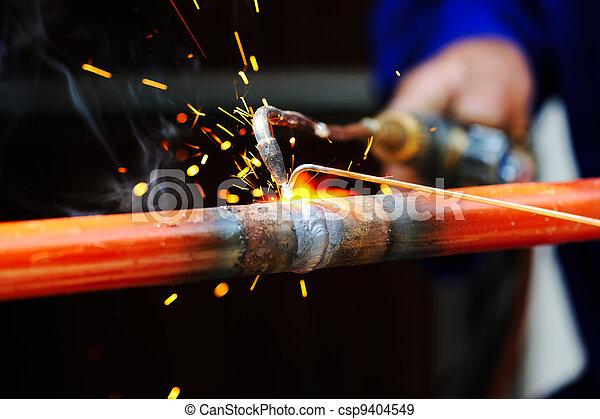 welder using torch on metal object - csp9404549