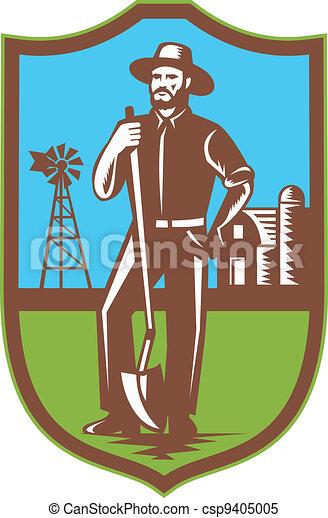 farmer standing leaning spade shovel - csp9405005