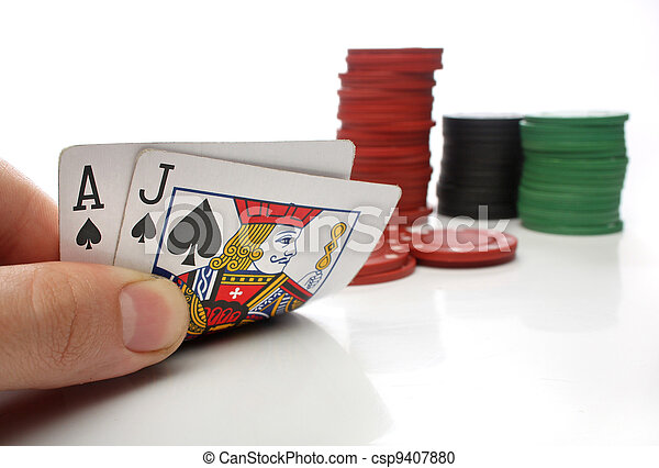 Blackjack. Human hand with blackjack cards and gambling over white - csp9407880