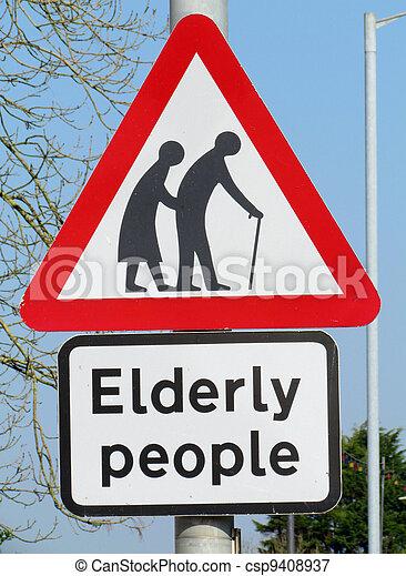 British elderly people crossing road warning sign. - csp9408937