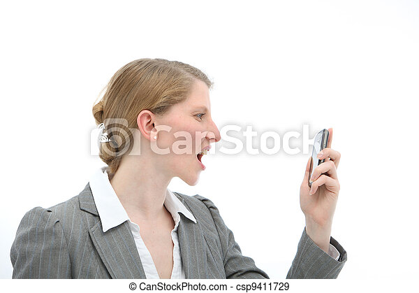 Horrified woman reading text message on phone - csp9411729