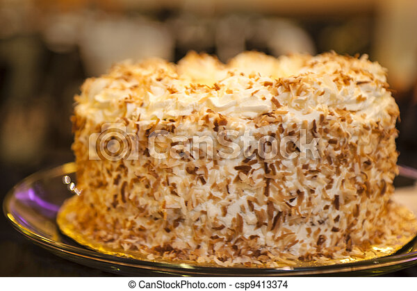 Cake with coconut sprinkled frosting - csp9413374