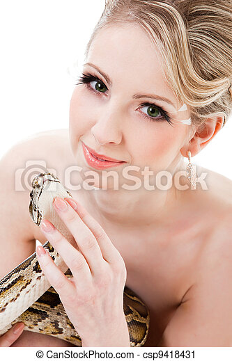 Beautiful woman holding Python on isolated white - csp9418431
