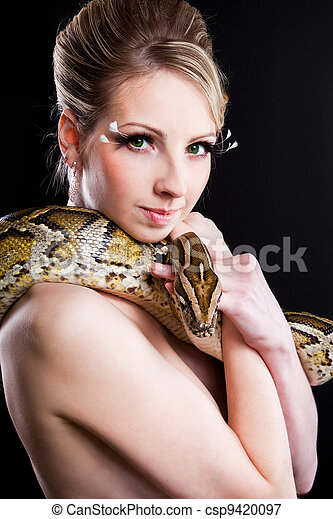 attractive nude blond woman with python on black - csp9420097