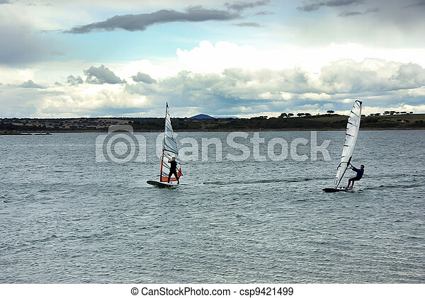 windsurfing on alqueva lake, Portugal - csp9421499