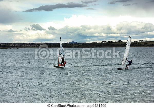 windsurfing on alqueva lake, Portugal - csp9421499