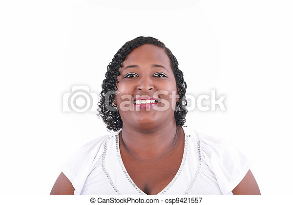 Portrait of a young beautiful black woman looking camera - csp9421557