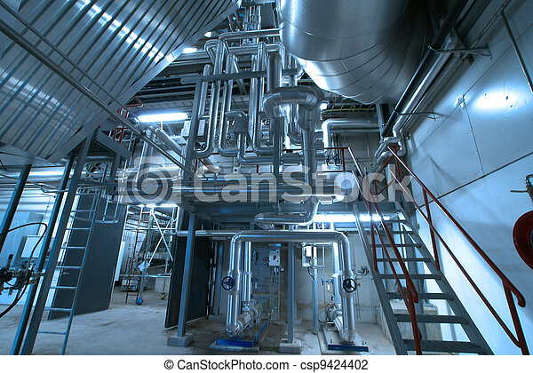 Equipment, cables and piping as found inside of a modern industrial power plant - csp9424402