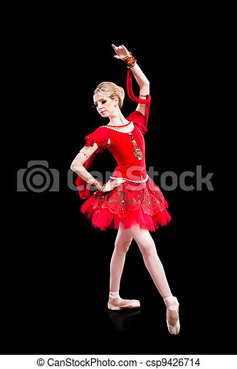 ballerina wearing red tutu posing on isolated black - csp9426714