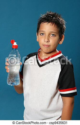 Thirsty boy drinking water - csp9435631