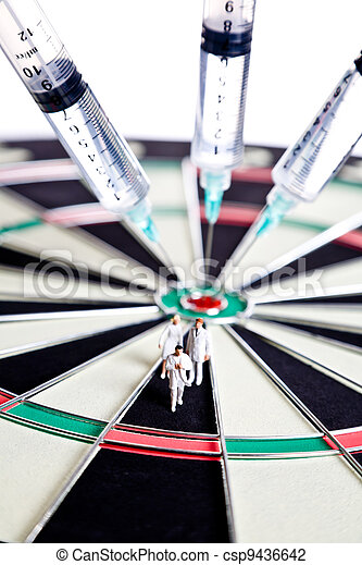 Syringes stuck in a dartboard   - csp9436642