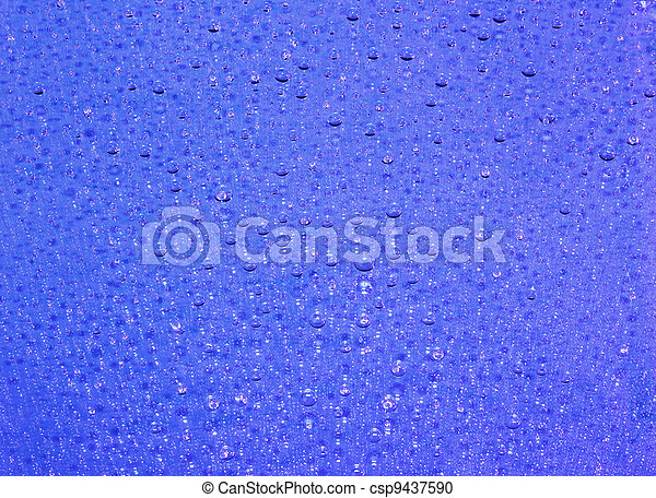 Blue abstract translucent water drops background, macro view - csp9437590