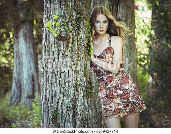 Fashion portrait of young sensual woman in garden - csp9437714