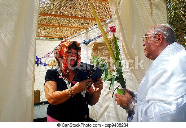 Praying in Sukkah for Jewish Holiday Sukkot - csp9438234