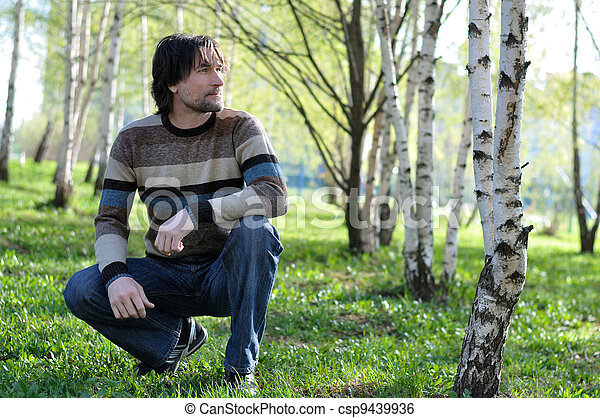 Middle-aged man in a birch grove - csp9439936