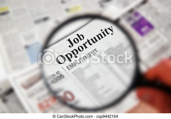 "Magnifying glass over a newspaper classified section with ""Job Opportunity"" text - csp9442164"