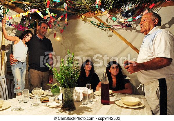 Israeli Family Celebrates the Jewish Holiday Sukkoth - csp9442502