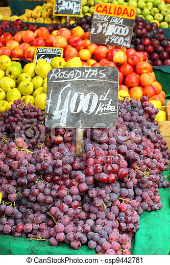 Red grapes at the local market in Valparaiso, Chile. - csp9442781
