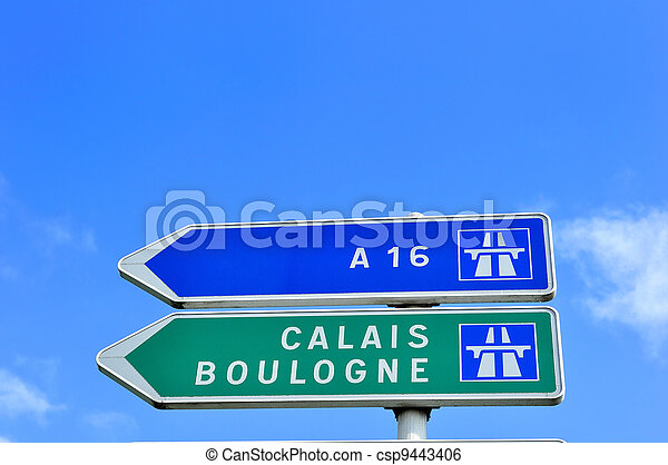 A French road sign pointing the way to Calais and Boulogne, two famous channel ports for ferry travel to the UK.  Copy space above. - csp9443406