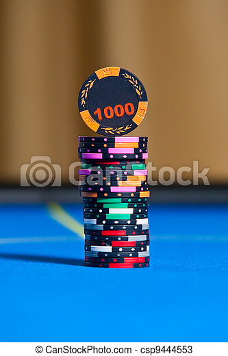 Gambling chips on casino table - csp9444553
