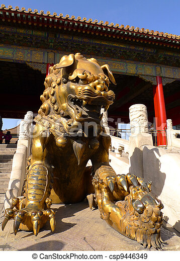 An imperial guardian lion (Shishi) in front of the gate of Heavenly Purity in the Forbidden City, Beijing, China. - csp9446349