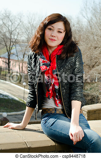 beautiful girl with brown hair and red scarf - csp9448718