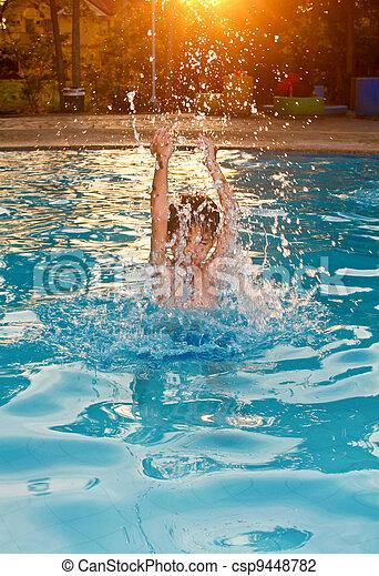 Boy Splashing Water - csp9448782