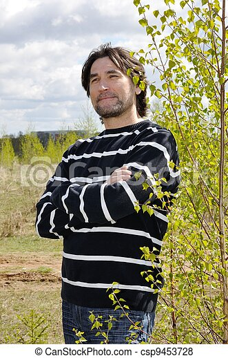 Middle-aged man in a birch grove - csp9453728