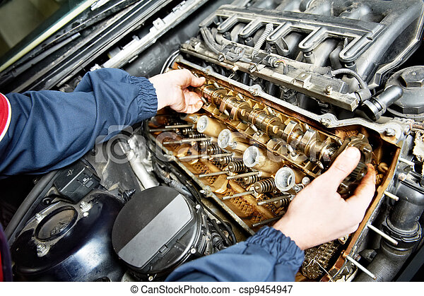 machanic repairman at automobile car engine repair - csp9454947