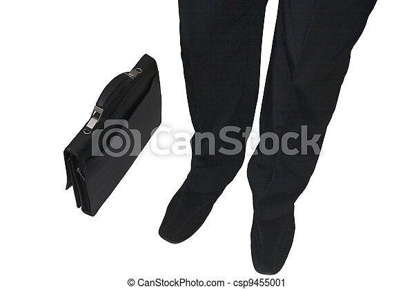business man and standing next to him brief-case on a white background - csp9455001