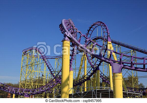 Roller coaster at a theme park - csp9457995