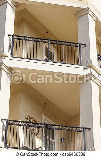 Stucco Balconies with Wrought Iron Railings - csp9460539