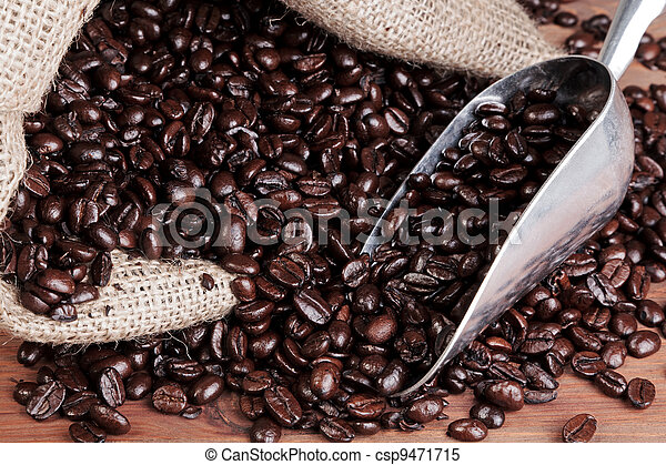 Coffee sack with scoop and beans. - csp9471715