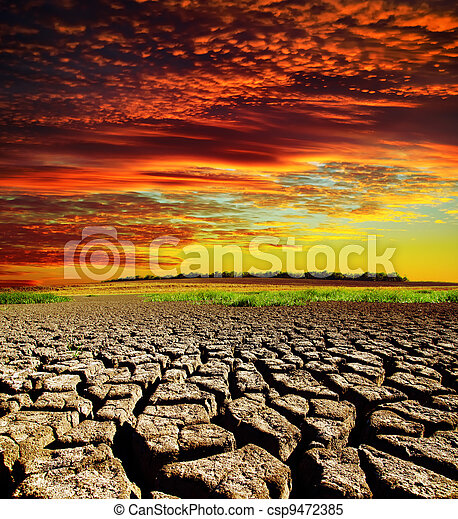 red dramatic sunset over dry cracked earth - csp9472385